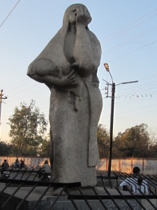 1985 sculpture by Holocaust survivor Ruth Waterman stands across the street from the walled-in factory site.  Gretchen Jennings. January 2014.